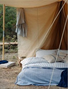 when camping - beautiful linens and cushions, maybe a comfy rug as well