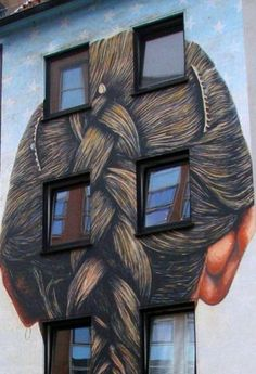street art. So... you're walking by and someone's hanging out the window so you yell, hey-- you got a person in your hair.