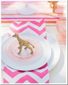Spray paint little plastic animals and use them as place cards.