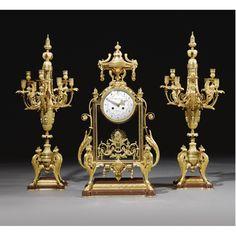 c1890 A gilt-bronze four-glass clock garniture by Ferdinand Barbedienne, Paris circa 1890 Estimate 15,000 — 25,000 GBP LOT SOLD. 27,500 GBP (Hammer Price with Buyer's Premium)