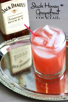 Jack Honey & Grapefruit cocktail drink recipe featuring Jack Honey and grapefruit juice. The Jack Honey & Grapefruit cocktail is just what it sounds like. Two ingredients, one sweet and one tangy, blend together to perfection. Easy Alcoholic Drinks, Liquor Drinks, Whiskey Cocktails, Cocktail Drinks, Cocktail Recipes, Beverages, Easy Whiskey Drinks, Drink Recipes, Cognac Drinks