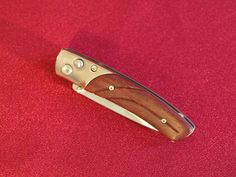 The Boker Plus Elegance exclusive pocket knife with handmade amaranth wooden handle.