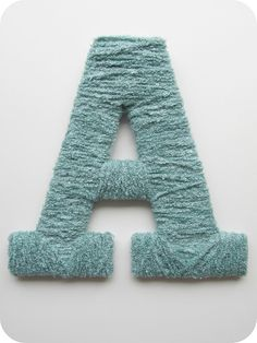 Instead of buying cardboard letter forms from the craft store, cut your own from foam board!