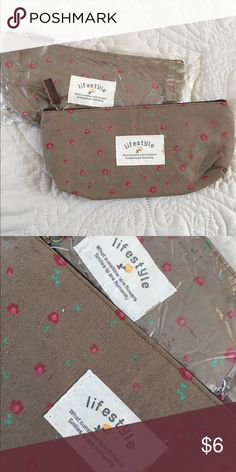 Brown floral zipper cases Both are nwt, ordered them online and one came in a plastic and one did not. Both for $6. Brown with small floral print. Can be used as makeup bags, pencil cases, etc Accessories