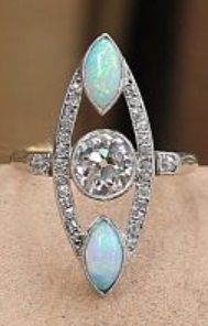 A Belle Epoque platinum, gold, diamond and opal ring. #BelleÉpoque #ring
