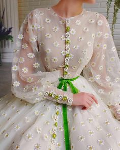Details - Powder dress color - Tulle dress fabric with chamomile flowers - Embroidered chamomile flowers - Green velvet ribbon - Long sleeves gown with an open leg - For special occasions Stylish Dresses For Girls, Elegant Dresses, Pretty Dresses, Vintage Dresses, Stylish Gown, Beautiful Dress Designs, Most Beautiful Dresses, Sleeves Designs For Dresses, Evening Dresses