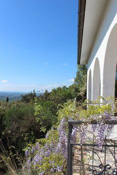 Our porch and the view in April, with the wisteria in bloom!  Villa degli Armeni - rental villa near Rome, Italy
