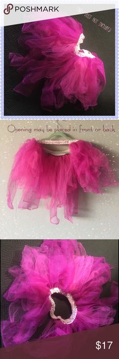 """Open Face Tutu 40% Off Bundles A truly unique fashion piece. Not just a costume!  Add this to your party wear or bridal shower fun. One of a kind creation with sections of 19"""" dark pink glitter tulle dangling over shorter 14"""" pieces of hot pink netting. With a Sequin elastic waistband measuring 13"""" not stretched. Look at images there is an opening which may be placed in front or back. Slip it on around your waist over a dress, shorts, jeans, skirt or as a costume piece. Item used for…"""