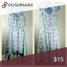 Floral Sleeveless High Low Dress Beautiful Sleeveless High Low Dress - Lined  Juniors Size Small  Elastic Waist Is Comfortable and Flattering  Pastel Floral Print Includes Blues, Greens, Yellow, and Pinks  Measurements Taken with Garment Lying Flat: Bust 32 Inches Waist 23 Inches Hips 30 Inches Length 31.5 Inches  Smoke Free, Pet Friendly Dresses High Low