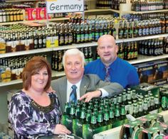 Tony Angotti, center, with business manager Susan Clapper and general manager Todd Clapper at Beers of the World in Henrietta.