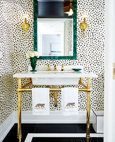 Adventurous mix of black and cream leopard, malachite, and brass | Powder room - Style At Home design editor Jessica Waks
