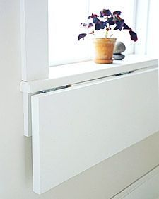 Extend a Windowsill: Select plywood the same thickness as sill; cut it as wide as sill and 12 inches deep. Attach bottom of shelf to bottom of sill with 3 hinges: 1 at the center, the others near the sides. Cut 2 right triangles from wood thin enough to lie flat beneath folded shelf; trim tips. Brackets should extend 3/4 of the way across shelf and 3/4 down apron. Hinge brackets to apron. Paint before installing.
