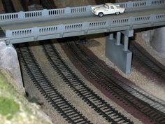 How to Attach an HO Scale Train Track to Wood