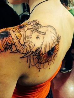 Mixed with flowers Elephant Tattoo on Shoulder.
