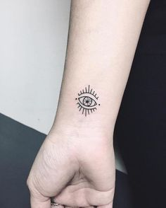 What does evil eye tattoo mean? We have evil eye tattoo ideas, designs, symbolism and we explain the meaning behind the tattoo. Little Tattoos, Mini Tattoos, Love Tattoos, Beautiful Tattoos, Body Art Tattoos, Small Tattoos, Tattoos For Women, Tatoos, Evil Eye Tattoos