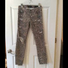 GUESS distressed cheetah print skinny jeans. GUESS distressed cheetah print skinny jeans. These jeans are in great condition! Guess Pants