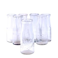 vintage glass milk bottles for a pop of rustic charm  #ascrentals #asouthernceremony #charleston #weddings