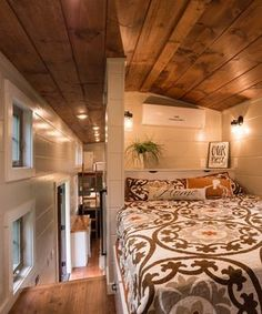 The main bedroom is located over the gooseneck deck, giving it extra headroom and space for a built-in wardrobe.