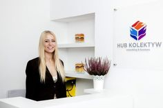Beautiful receptionist welcomes you with a smile.