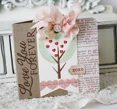 Bookpage & tag - nice.  Check the bow w/ button and sewn on paper hearts.