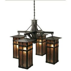 Steel Partners San Carlos 4 Light Chandelier Finish: Old Iron, Shade / Lens: Amber Mica