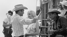 Montgomery Clift,, Marilyn Monroe and Clark Gable in the Nevada Desert, 1960. Background left is Magnum photographer Elliott Erwitt; background right are playwright Arthur Miller (Monroe's husband) and director John Huston. Photo by Ernst Haas / Getty Images