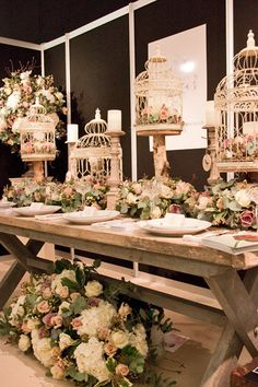 #Wedding #birdcages with #flowers. See the post at http://tulleandtwine.com/2013/11/20/birdcages-flowers