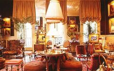 Interiors: The drawing-room of Kenneth Jay Lane's Park Lane apartment in New York. Beneath the elaborately moulded soapstone ceiling hangs a series of fringed shades by the French interior designer Vincent Fourcade