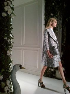 Cara Delevingne walks Elemental Design's lavish English country-themed Catwalk at London Fashion Week wearing the Mulberry Spring/Summer 2014 collection.