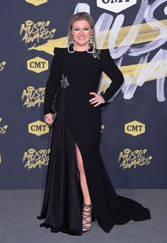 Glimpse of leg: Kelly Clarkson - who is making her CMT Music Awards debut performance - sported a flowing black gown with thigh-high slit and statement diamond earrings Cmt Music Awards, Celebrity Style Casual, Kelly Clarkson, Red Carpet Looks, Star Fashion, Celebs, Celebrities Fashion, Gowns, Street Style