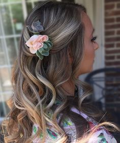 Bridal style hair down and curled half up style with flower by Meliss