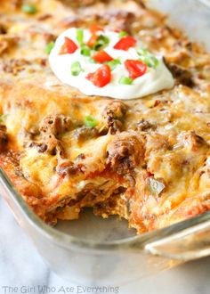 Taco Lasagna - only 7 ingredients. So easy! {The Girl Who Ate Everything} #cincodemayo
