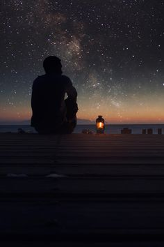 stars sky lonely infinite milky way man lamp sunset deck