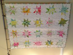 Wonky Stars quilt made with Heather Bailey's Nicey Jane fabric. Birdinhandquilts.wordpress.com