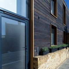 Shou-Sugi-Ban® can supply, design and install charred timber cladding for all projects. Charred Wood, Cedar Siding, Timber Cladding, Passive House, Wooden Walls, House Front, Home Projects, Exterior Design, Townhouse