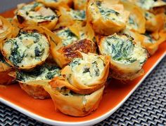 Spanakopita Bites- this website has a ton of fancy but easy party food ideas!!! I have to remember this site!!