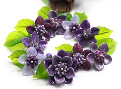 Hibiskus lila by Jopanda Glassworks I have this in vintage plastic !