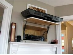 Great Idea for a flat screen tv mount, all devices hidden behind in a hidden cabinet!