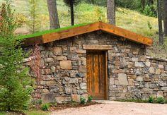 Possible wine, munitions, root, storm cellar, or workshop.  Built into hillside.