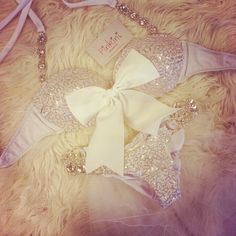 I'd wear a button up shirt over it and put the bow through in between the buttons to show it off :)