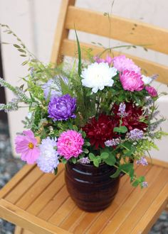 A real country vase with aster, mint, and grasses.