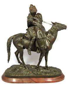 """Yevgeny Alexandrovich Lancerey (St. Petersburg 1848 - 1886). Russian bronze group figure depicting a Cossack kissing his girl goodbye. Titled """"Farewell Kiss"""". Signed in Cyrillic to bronze base. Sculpture is mounted on a red marble oval base. Measures 15 3/4"""" height x 15 1/2"""" length + 7/8"""" base height (40cm x 39.4cm + 2.2cm). Pre-Sale estimate $2000-$3000."""
