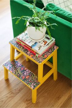 Add some colorful pattern to an old step stool using peel-and-stick wallpaper!  This stool from thislittlestreet.com is covered with a beautiful floral pattern that brightens up a boring piece of furniture.