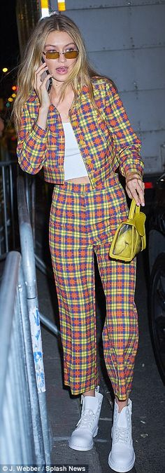 Dizzying: She arrived to the event in style as she sported a checked yellow, blue, and orange suit