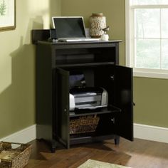 Edge Water Computer Lifestyle Center Estate Black Finish by Sauder. $129.95. Computer center features a removable laptop shelf with a cushioned pad that allows you to move you work away from the main station, providing convenient flexibility. Open space above shelf is 17''D x 55/8''H. Flipup panel on top reveals a Digital Dock for parking, recharging, and syncing mobile electronics like phones, cameras, or PMPs. Convenient cord management reduces clutter and ke...