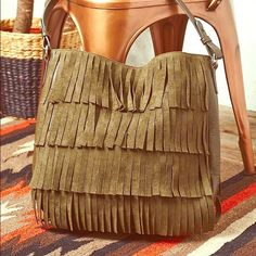 Free People Ashbury Fringe Tote Beautiful olive green fringe tote. Suede fringe tassels give this bag a boho flair with 100% vegan leather. Very roomy interior with snap closure and 3 separate interior pockets. Carried once, like new condition. Free People Bags Totes