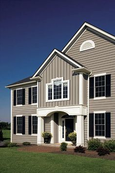 siding colors. similar to what we will do. taupe gray siding with white trim and black/gray shutters and door. We also have brick.