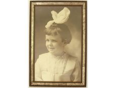Darling vintage sepia toned photograph of a little girl with a big hair bow will make an instant ancestor for you! The black and white picture,