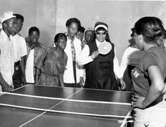 1979: Sister Assisi playing ping pong in her shades at the New Community Homes.
