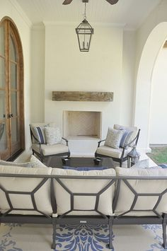 outside-rug, off white cushions, herringbone fireplace